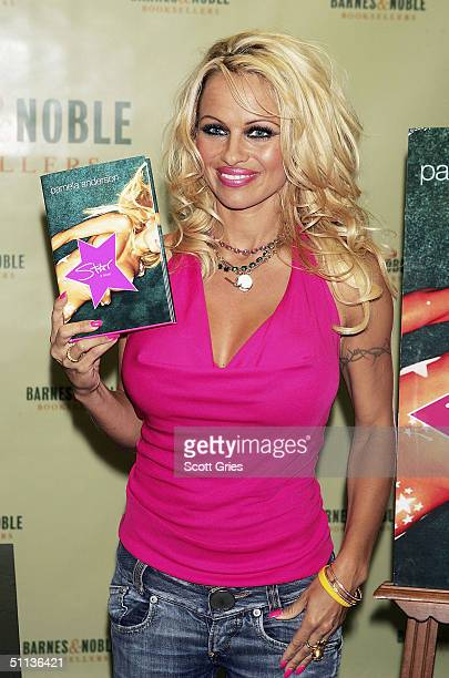"Model/actress Pamela Anderson poses for photos during an in store appearance to sign copies of her new novel ""Star"" at Barnes & Noble in Rockefeller..."