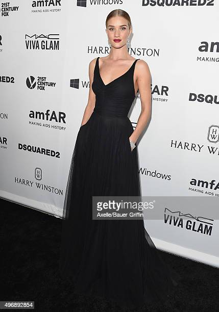 Model/actress Rosie HuntingtonWhiteley arrives at amfAR's Inspiration Gala Los Angeles at Milk Studios on October 29 2015 in Hollywood California
