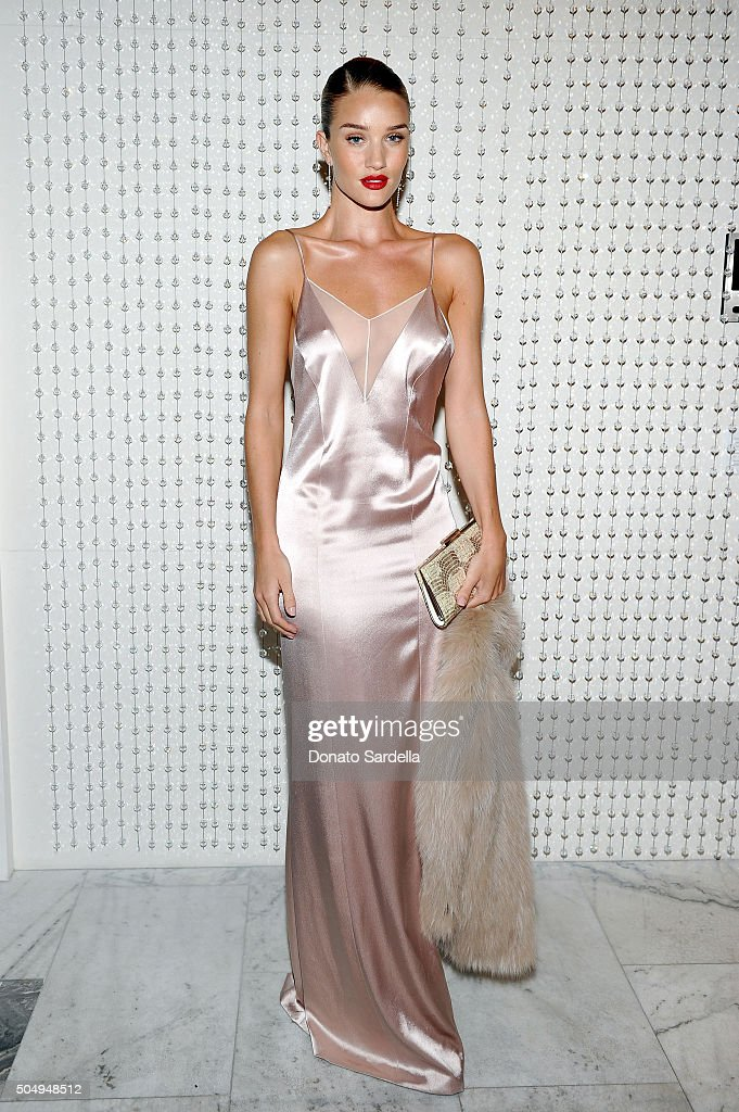 Model/actress Rosie Huntington-Whiteley attends the Galvan For Opening Ceremony Dinner Hosted By Swarovski at Private Residence on January 13, 2016 in Los Angeles, California.
