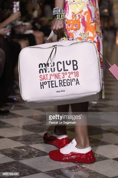 Model,bag detail, walks the runway during Miu Miu 2019 Cruise Collection Show at Hotel Regina on June 30, 2018 in Paris, France.