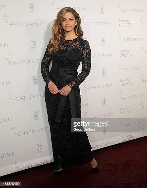 Model/designer Camila Alves arrives at The Art Of Elysium's 8th Annual Heaven Gala at Hangar 8 on January 10 2015 in Santa Monica California