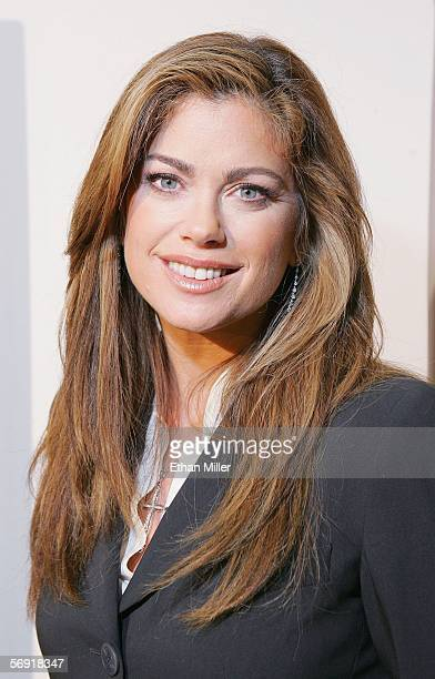 """Model/designer Kathy Ireland poses at her """"ki by Orioxi Collection"""" booth at the MAGIC convention, held at the Las Vegas Convention Center February..."""