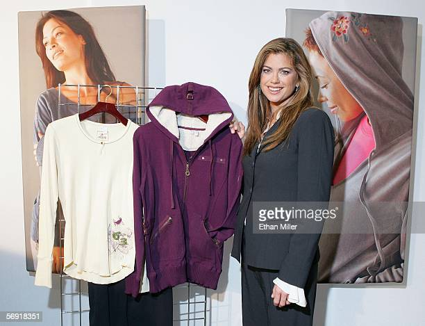 """Model/designer Kathy Ireland poses with some of her """"ki by Orioxi Collection"""" pieces at the MAGIC convention, held at the Las Vegas Convention Center..."""