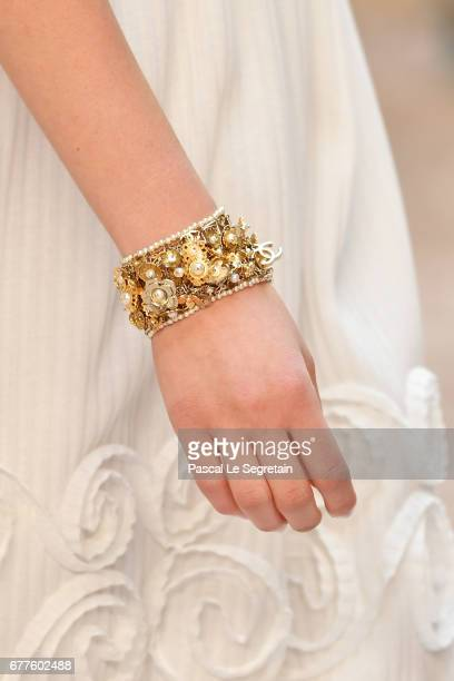 A modeljewelry detail walks the runway during Chanel Cruise 2017/2018 Collection at Grand Palais on May 3 2017 in Paris France