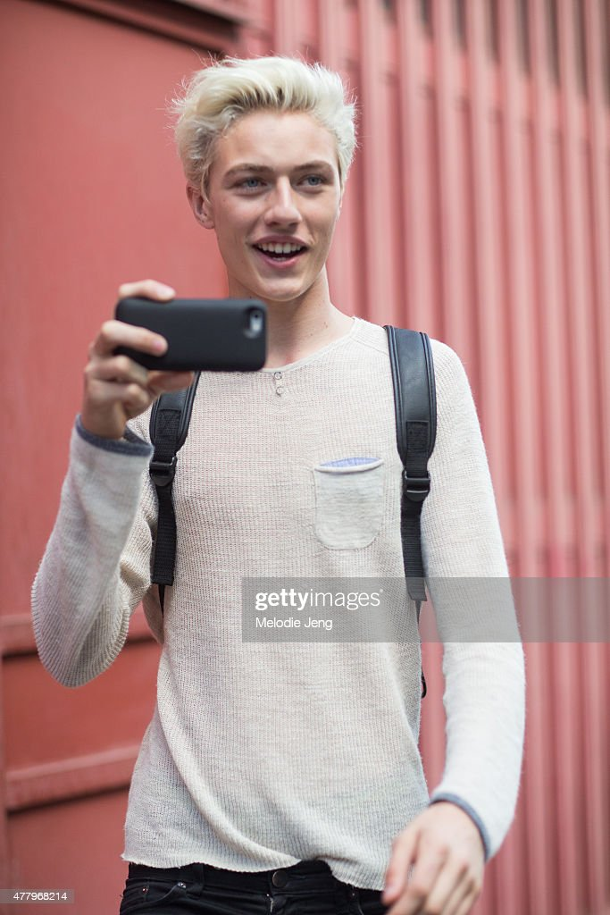 Model/Musician Lucky Blue Smith exits the Salvatore Ferragamo show and shoots a video of the photographers on June 21, 2015 in Milan, Italy.