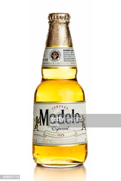 modelo special bottle on white background - mexican beer stock pictures, royalty-free photos & images