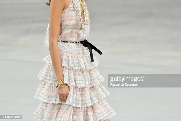 A modeloutfit detail walks the runway during Chanel Cruise 2020 Collection at Le Grand Palais on May 03 2019 in Paris France