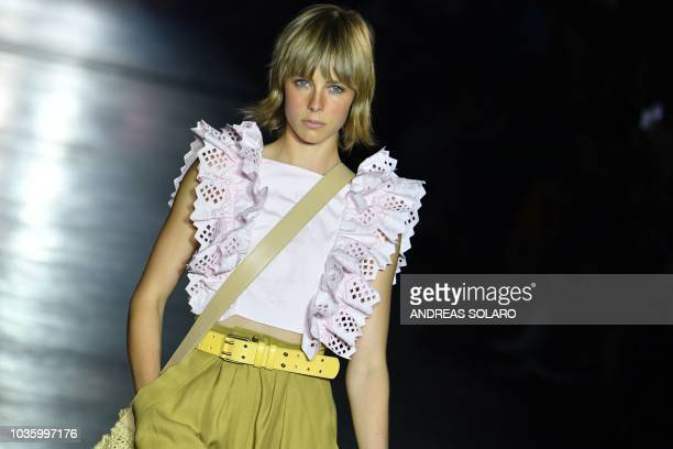 A modelpresents a creation by Alberta Ferretti during her Women's Spring/Summer 2019 fashion show in Milan on September 19 2018