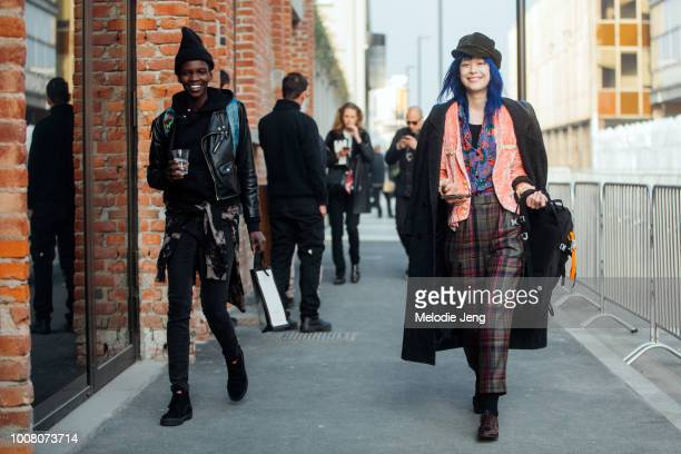 Models Achok Majak and Mae Lapres after the Gucci show during Milan Fashion Week Fall/Winter 2017/18 on February 22 2017 in Milan Italy Achok wears...
