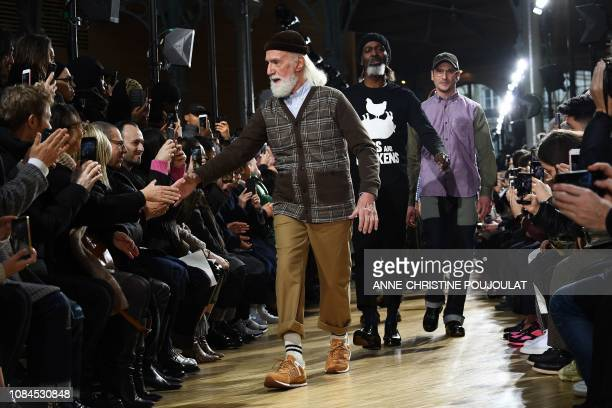 Models acknowledge the audience at the end of the Junya Watanabe Man men's Fall/Winter 2019/2020 collection fashion show in Paris on January 18 2019