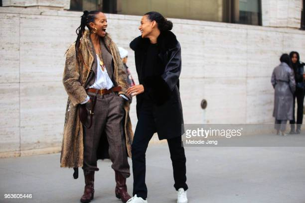Models Adesuwa Aighewi Binx Walton share a laugh after the Michael Kors show at Lincoln Center on February 14 2018 in New York City Adesuwa wears a...