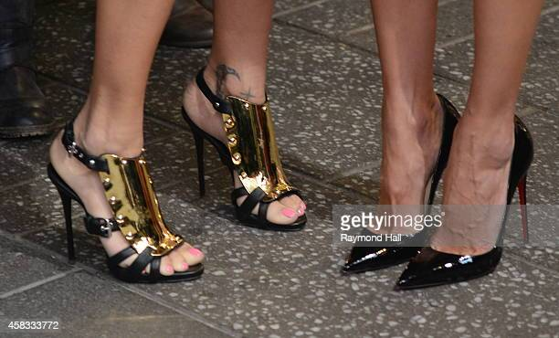 Models Adriana Lima and Alessandra Ambrosio enter the 'Good Morning America' taping at the ABC Times Square Studios on November 3 2014 in New York...
