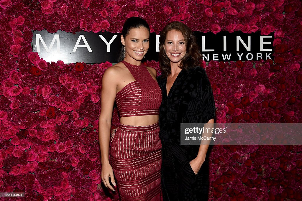 Models Adriana Lima (L) and Christy Turlington attend Maybelline New York Celebrates New York Fashion Week at Sixty Five on September 13, 2015 in New York City.