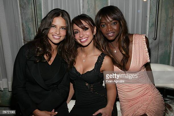 Models Adriana Lima and Oluchi Onweagba pose with singer Mya the launch party for the new photo book 'Backstage Sexy' at Spice Market February 11...