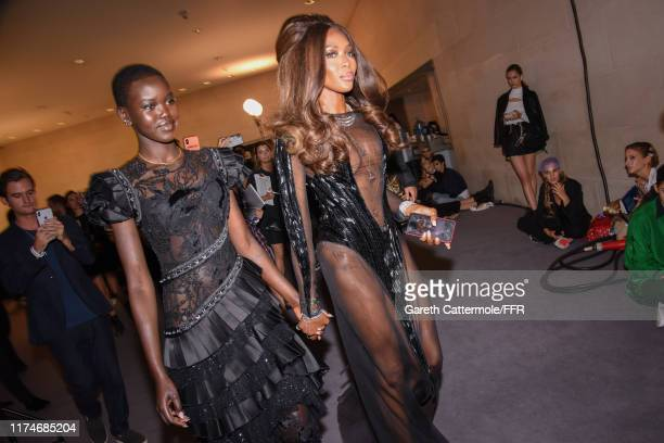 Models Adut Akech and Naomi Campbell backstage during Fashion For Relief London 2019 at The British Museum on September 14 2019 in London England