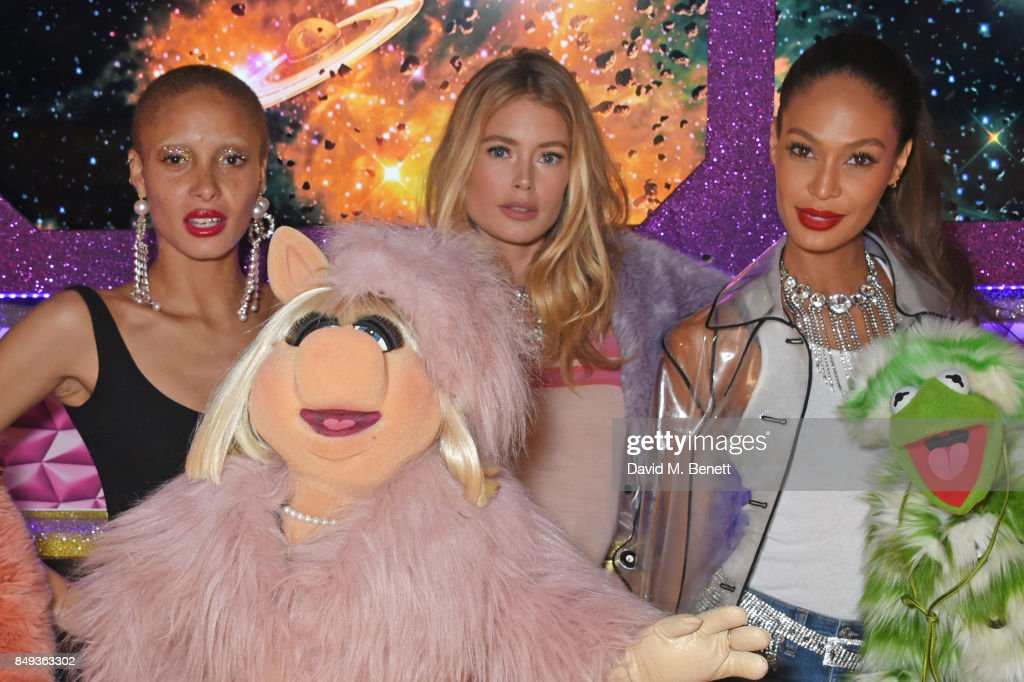Models Adwoa Aboah, Doutzen Kroes and Joan Smalls pose with Miss Piggy and Kermit The Frog at the LOVE magazine x Miu Miu party, held during London Fashion Week, at Loulou's on September 18, 2017 in London, England.