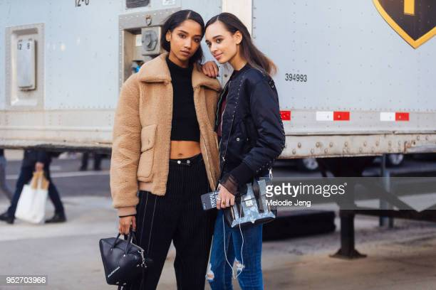 Models Aiden Curtiss Nandy Nicodeme after the 31 Phillip Lim show on February 12 2018 in New York City Aiden wears a brown teddy bear jacket and...