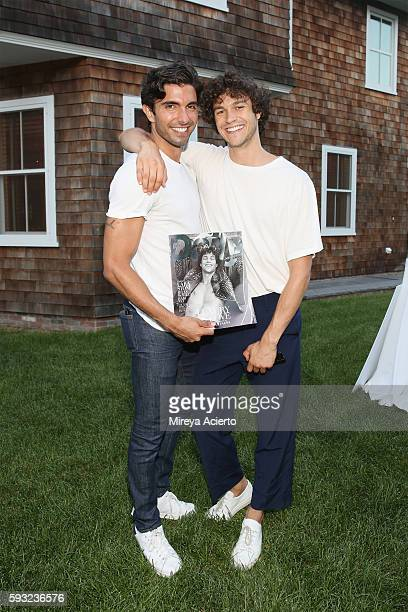 Models Akin Akman and Miles McMillan attend Daily Front Row's 'Luxury and Love' party at Inn at Windmill Lane on August 20 2016 in Amagansett New York