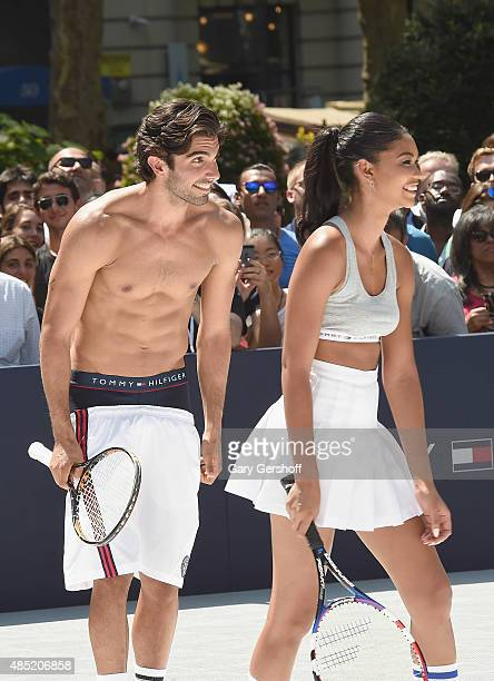 Models Akin Arkman and Chanel Iman attend the Tommy Hilfiger And Rafael Nadal Launch Global Brand Ambassadorship at Bryant Park on August 25 2015 in...