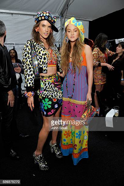 Models Alessandra Ambrosio and Devon Aoki pose backstage at the Moschino Spring/Summer 17 Menswear and Women's Resort Collection during MADE LA at LA...