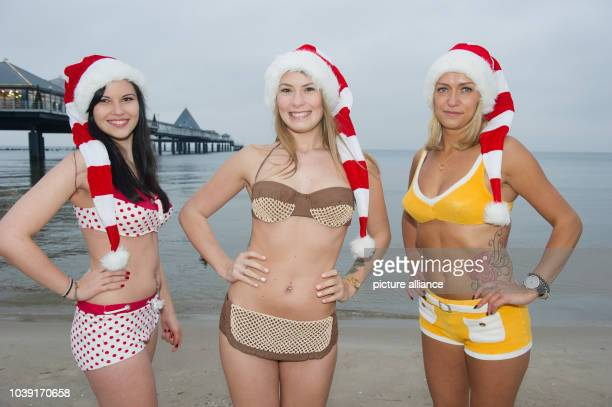 Models Alexandra, Jennifer and Karoline wearing historic bikinis from the Juergen Kraft collection from the 1960s, the 1950s and 1970s, on the beach...
