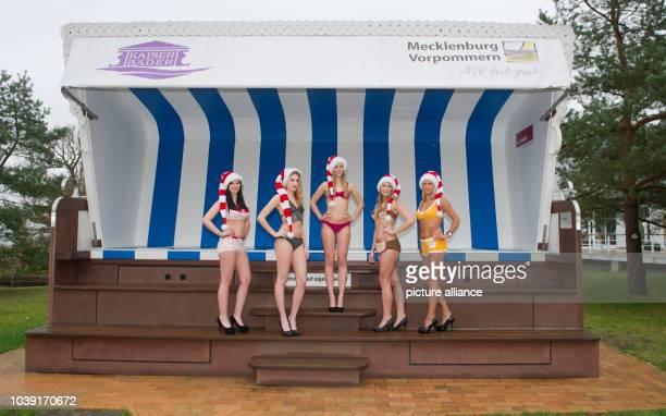 Models Alexandra, Julia, Sara, Jennifer and Karolina wearing bikini fashions from various decades on the promenade at Heringsdorf on the island of...