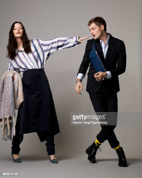 Models Alice Gilbert and Adrien Jacques pose at a fashion shoot for Madame Figaro on November 14, 2017 in Paris, France. Alice: shirt, skirt, pants,...