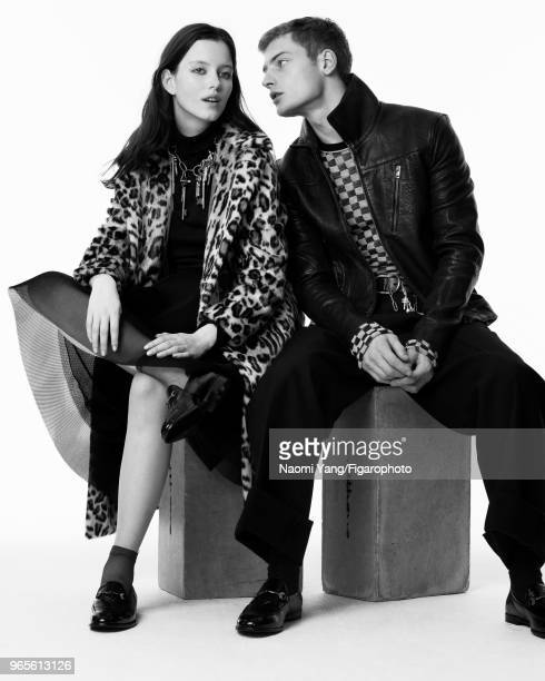 Models Alice Gilbert and Adrien Jacques pose at a fashion shoot for Madame Figaro on November 14 2017 in Paris France Alice coat by Maliparmi polo by...