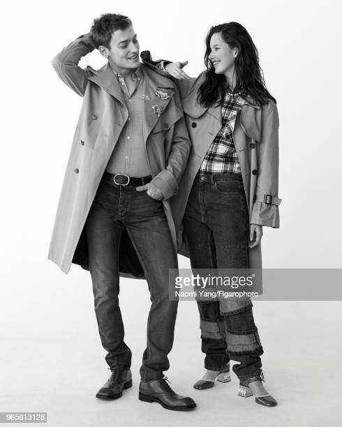 Models Alice Gilbert and Adrien Jacques pose at a fashion shoot for Madame Figaro on November 14 2017 in Paris France Adrien trenchcoat by Paul Smith...