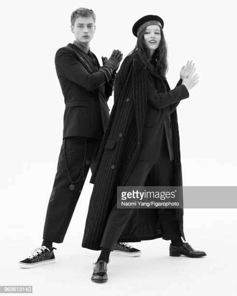 Models Alice Gilbert and Adrien Jacques pose at a fashion shoot for Madame Figaro on November 14 2017 in Paris France Adrien suit pullover shirt tie...