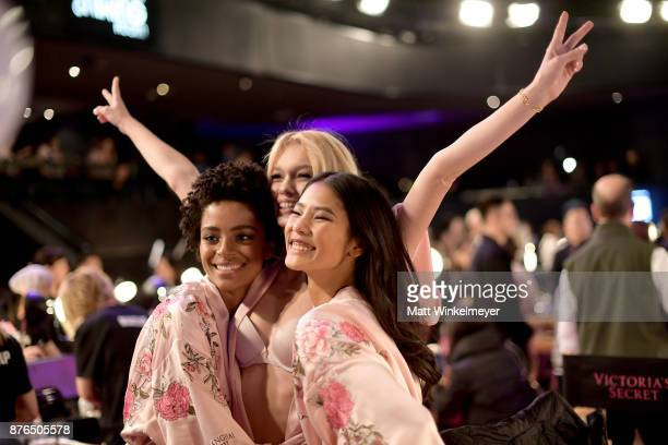 Models Alicia Morias Maggie Laine and Ming Xi pose in Hair Makeup during 2017 Victoria's Secret Fashion Show In Shanghai at MercedesBenz Arena on...