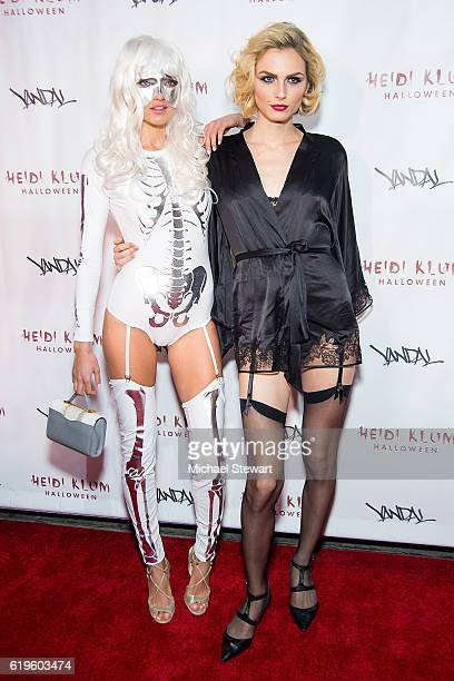 Models Alina Baikova and Andreja Pejic attend Heidi Klum's 17th Annual Halloween party at Vandal on October 31 2016 in New York City