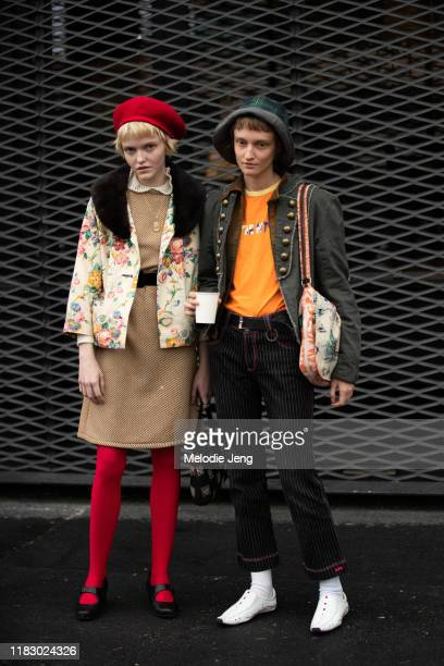 Models Allison Hampton and Greta Mateides wear vintage-style outfits after the Gucci show during Milan Fashion Week Spring/Summer 2020 on September...