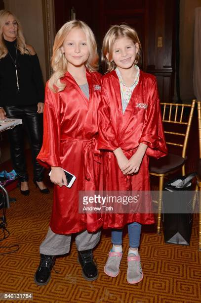 Models Alyvia Lind and Ciel Taylor prepare backstage at the Sherri Hill NYFW SS18 fashion show at Gotham Hall on September 12 2017 in New York City
