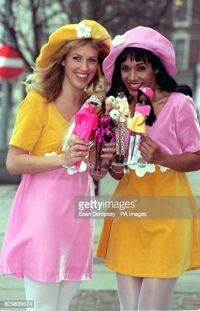 Models Amanda Grant and Resi with four of the latest Barbie dolls at the British International Toy and Hobby Fair in London