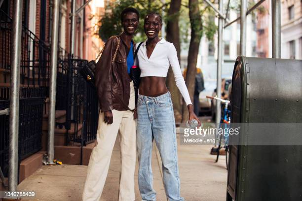 Models Amar Akway and Awar Odhiang after the Altuzarra show on September 12, 2021 in New York City. Amar wears a brown leather jacket, black leather...