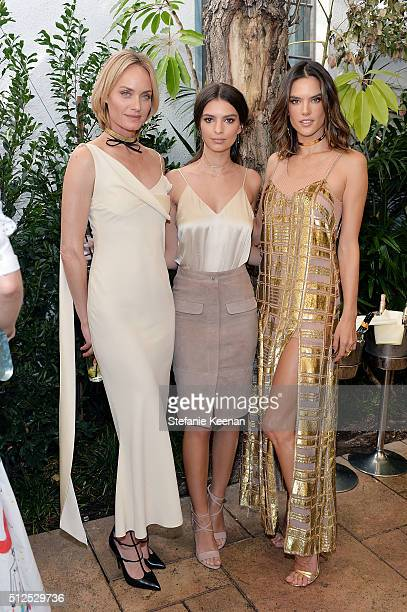 Models Amber Valletta Emily Ratajkowski and Alessandra Ambrosio attend NETAPORTER Celebrates Women Behind The Lens at Chateau Marmont on February 26...
