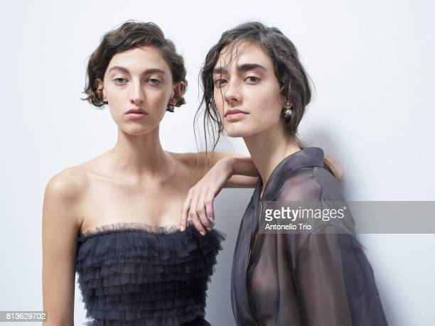 Models Amber Witcomb and Amanda Googe pose Backstage prior the Christian Dior Haute Couture Fall/Winter 20172018 show as part of Haute Couture Paris...
