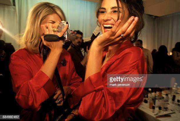 Models Ana Hickman and Caroline Ribeiro have a fun moment backstage prior to the 8th Annual Victoria's Secret Fashion Show Photo by Mark...