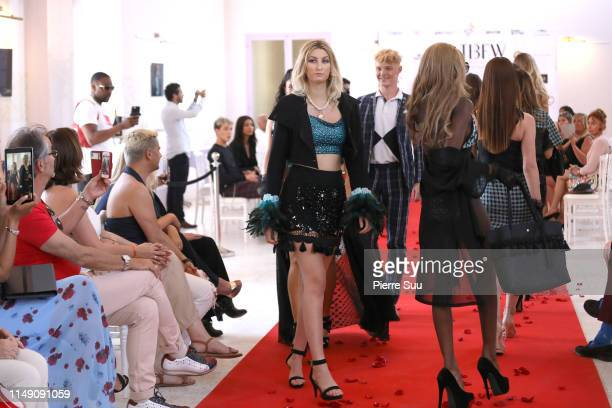 Models and Alex Pike walk the runway during the Alex Pike show at BNTB Cannes Fashion Week on May 14 2019 in Cannes France