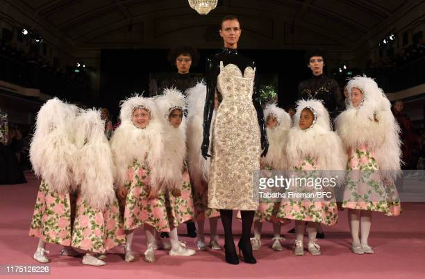 Models and children on the runway at the Richard Quinn show during London Fashion Week September 2019 at York Hall on September 16, 2019 in London,...