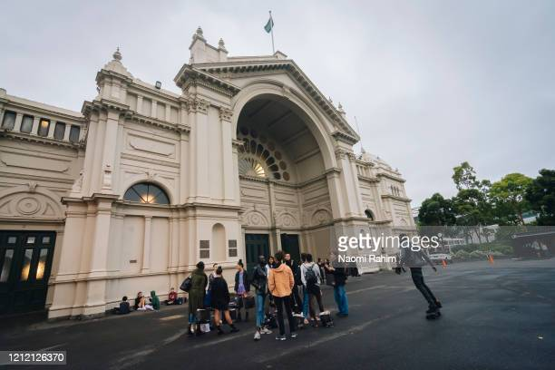 Models and crew leave the Royal Exhibition Building on March 13 2020 in Melbourne Australia Melbourne Fashion Festival organisers announced on Friday...