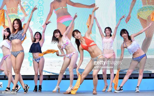 Models and dancers wearing new bikinis perform a promotional flash mob dance on stage in Tokyo on July 17 2017 The event was organized by the Japan...