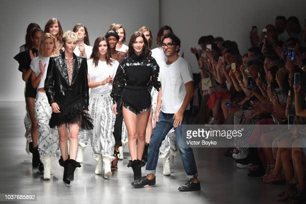 Models and designer Lorenzo Serafini walk the runway at the Philosophy Di Lorenzo Serafini show during Milan Fashion Week Spring/Summer 2019 on...