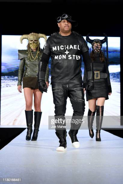 Models and designer walk the runway for Michael Lombard at the House of iKons show during London Fashion Week February 2019 at the Millennium...