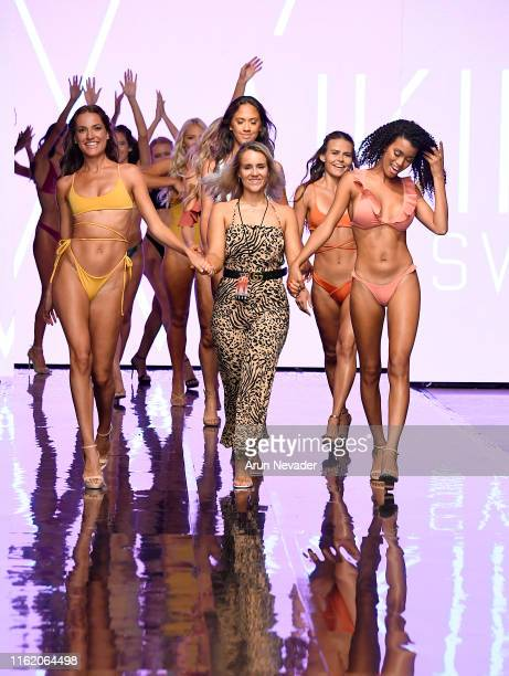 Models and designer walk the runway with the WAIKIKI designer during the WAIKIKI SWIM show At Miami Swim Week Powered By Art Hearts Fashion...