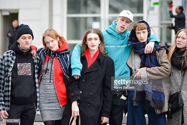 Models and guests pose after the Balenciaga show during Paris Fashion Week FW 16/17 on March 6 2016 in Paris France