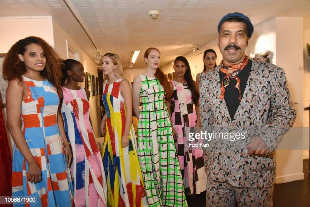 Models and Karim Bonnet fashion designer of Impasse De la Defense attend the Impasse De La Defense Show At Galerie 59 Rue de Rivoli on November 2,...