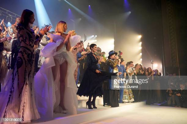 Models and performers are seen onstage after walking the runway at the Jean-Paul Gaultier 50th Birthday show at Theatre du Chatelet on January 22,...