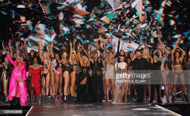 Models and performers wave at the end of the 2018 Victoria's Secret Fashion Show on November 8, 2018 at Pier 94 in New York City. - Every year, the...